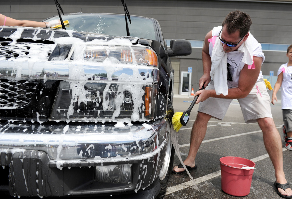 Description of . (John Valenzuela/Staff Photographer) Russell Loy helps wash a car during the bike/car wash fundraiser in memory of his granddaughter Breann Creer at the Citizens Business Bank Arena in Ontario, Saturday, August 31, 2013. Creer, 4, who died earlier this week when the motorcycle she was riding on collided with a big rig in Rancho Cucamonga.