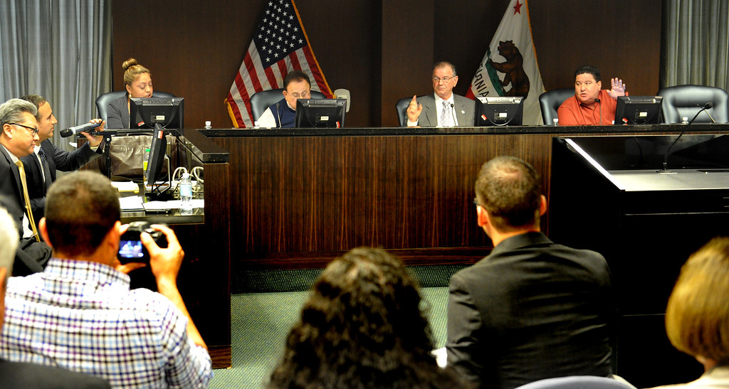 Description of . Central Basin Municipal Central Basin Municipal Water District directors meet, without Director James Roybal with his seat empty (far right) as they discuss agenda items including the imminent loss of the district's insurance policy and receive another report on the alleged $2.7 million slush fund during their meeting in Commerce on Monday March 24, 2014. (Staff Photo by Keith Durflinger/Whittier Daily News)