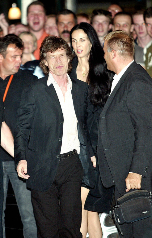 Description of . Rolling Stones frontman Mick Jagger celebrating 26 July 2003 in Prague his sixtieth birthday smiles to wellwishers as he and L'Wren Scott, former model and US stylist enter a select VIP Duplex club at Wenceslas Square. The Rolling Stones were in Prague on the latest leg of their