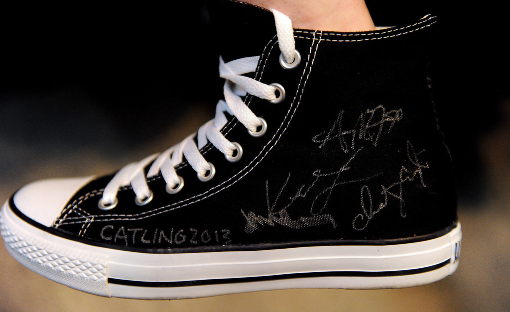 Description of . The Masters of Fine Arts students decorated their black Converse shoes with signatures from the faculty during the summer commencement ceremony at Azusa Pacific University on Friday, July 26, 2013 in Azusa, Calif.  (Keith Birmingham/Pasadena Star-News)