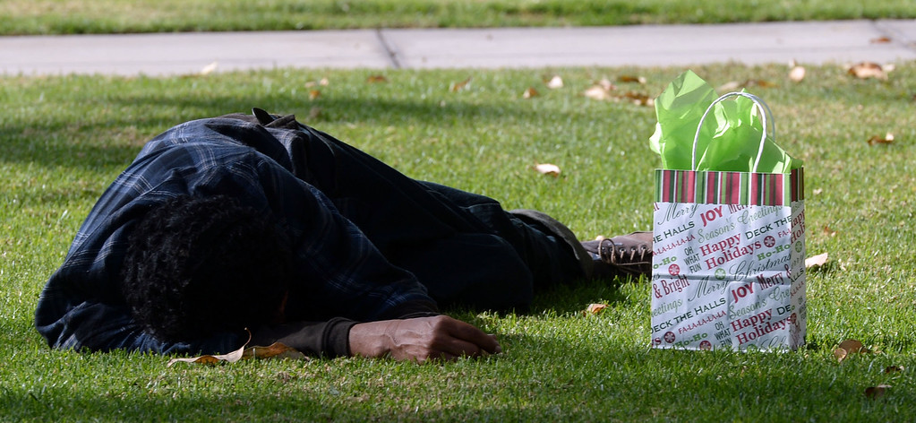 Description of . Jessica Zuniga (not pictured) leaves a gift bag for a homeless man that was sleeping on the grass at the Whittier transportation Center in Whittier, Calif., on Saturday, Jan.4, 2014. Zuniga was given a large sum of money by an unidentified man at Target when he thought she had no money.   (Keith Birmingham Pasadena Star-News)