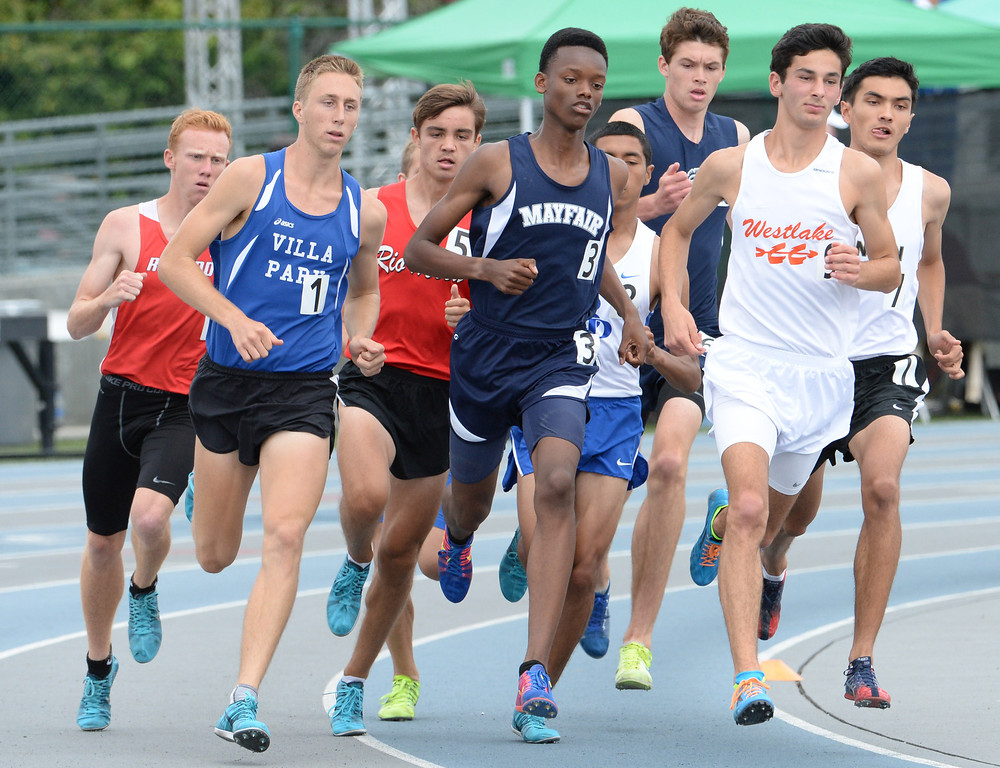 Description of . Mayfair's Ellis Newton competes in the division 2 1600 meter run during the CIF Southern Section track and final Championships at Cerritos College in Norwalk, Calif., on Saturday, May 24, 2014. 