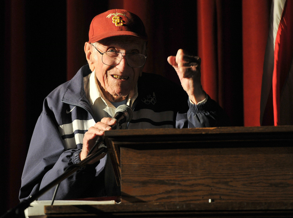 Description of . Torrance legend Louis Zamperini paid a visit to his alma mater Torrance High to visit with alumni and meet students. Zamperini pumps his fist to acknowledge cheers from students.   (3/31/11) (Photo by Robert Casillas/Daily Breeze)