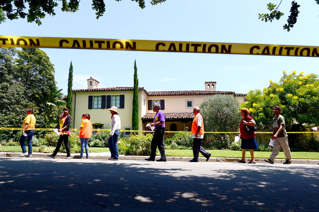 Description of . Occupy and ACCE protesters descend on the home of Timothy Sloan, chief financial officer of Wells Fargo, in San Marino to protest foreclosures Saturday, July 27, 2013. (SGVN/Staff Photo by Sarah Reingewirtz)