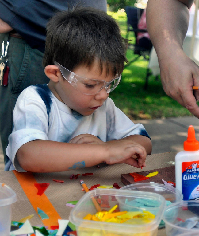 Description of . Five year-old Logan Cross makes a Mothers Day gift at the Artist Community of Whittier's stained glass mosaic booth.  The 119th anniversary of the founding of Whittier was celebrated during Founders Day at Central Park in Uptown Whittier, Saturday, May 11, 2013.  (Mike Mullen)
