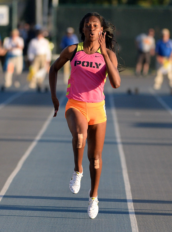 Description of . Long Beach Poly's Arianna Washington, center, center wins the 100 meter dash during the CIF-SS Masters Track and Field meet at Falcon Field on the campus of Cerritos College in Norwalk, Calif., on Friday, May 30, 2014.   (Keith Birmingham/Pasadena Star-News)