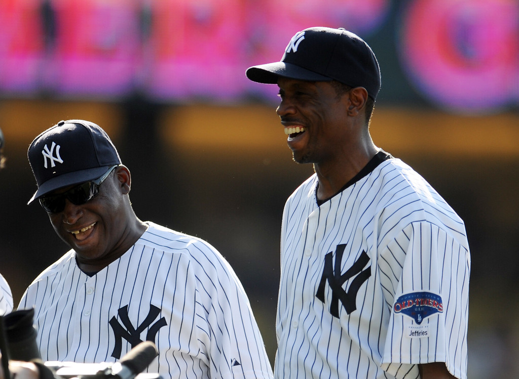 Description of . Former New York Yankee Doc Gooden with Al Downing during the Old-Timers game prior to a baseball game between the Atlanta Braves and the Los Angeles Dodgers on Saturday, June 8, 2013 in Los Angeles.   (Keith Birmingham/Pasadena Star-News)