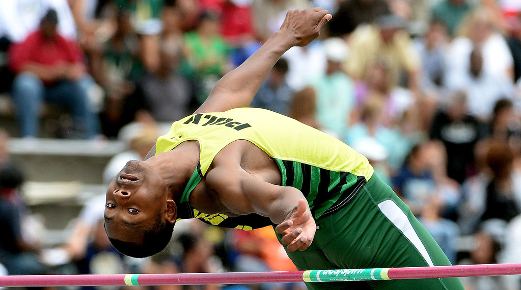 Description of . Long Beach Poly's Vincent Calhoun competes in the division 1 high jump during the CIF Southern Section track and final Championships at Cerritos College in Norwalk, Calif., Saturday, May 24, 2014. 