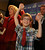 Wendy Greuel holds her son Thomas Schramm,9, hand up in victory. Greuel held her election night party at the Los Angeles Brewing Company in downtown Los Angeles, CA 3/5/2013(John McCoy/Staff Photographer)