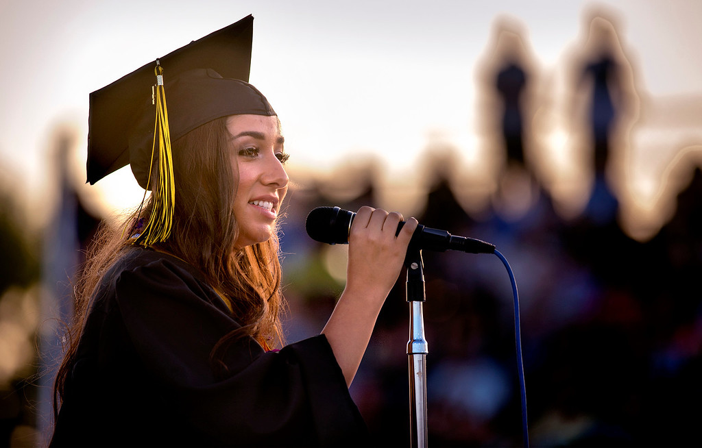 Description of . Graduate Ana Mejia delivers her speech during the Northview High graduation ceremony at Covina District Field June 11, 2014.   (Staff photo by Leo Jarzomb/San Gabriel Valley Tribune)