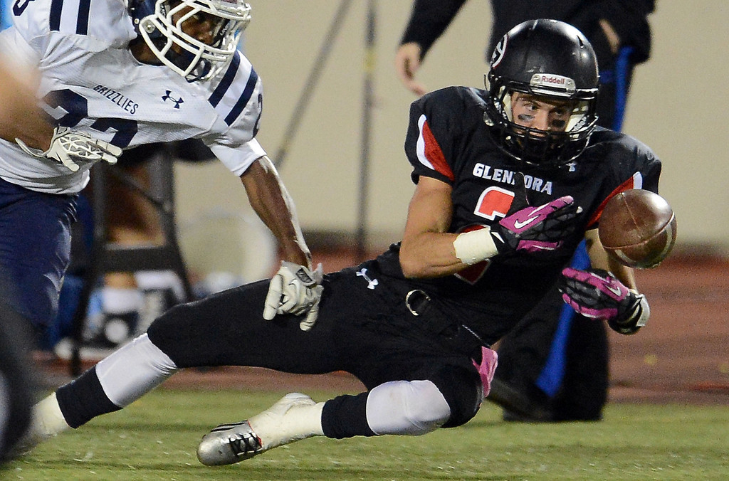 Description of . Glendora's Briton Noskoff (2) can't hold onto a pass against Los Osos in the first half of a prep football game at Citrus College in Glendora, Calif., on Thursday, Oct. 31, 2013.    (Keith Birmingham Pasadena Star-News)