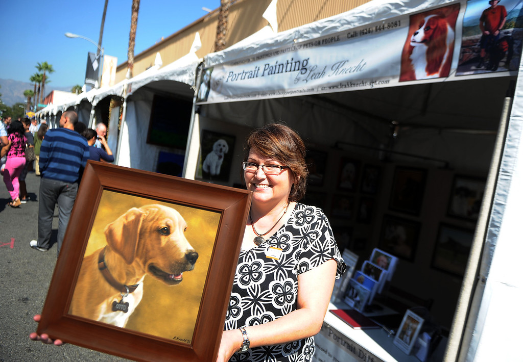 Description of . Artist Leah Knecht with one of her favorite paintings during the 8th Annual Pasadena ARTWalk along El Molino Avenue between Colorado Boulevard and Green Street in Pasadena, Calif., on Saturday, Oct. 12, 2013. The ArtWalk features over 30 participating artists, art sales, gallery walks, musical performances and other activities.   (Keith Birmingham Pasadena Star-News)