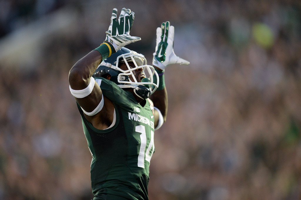 Description of . Michigan State's Tony Lippett #14 reacts after scoring the go ahead touchdown in the 4th quarter against Stanford during the 100th Rose Bowl game in Pasadena Wednesday, January 1, 2014. Michigan State defeated Stanford 24-20. (Photo by Hans Gutknecht/Los Angeles Daily News)