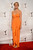 Actress Julie Bowen wears an orange V-neck column gown with draped front from the Catherine Malandrino's Resort 2013 Black Label Collection at the Writers Guild Awards at JW Marriott Los Angeles at L.A. LIVE on Feb. 17, 2013.