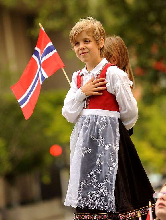 Description of . Freya Hendrickson, 9, crosses her heart during the singing of the United States National Anthem  during a Norway Constitution Day celebration in downtown San Bernardino May 17, 2013.  GABRIEL LUIS ACOSTA/STAFF PHOTOGRAPHER.