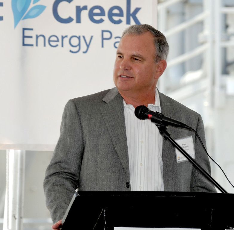 Description of . City of Industry Mayor Jeff Parriott speaks as Edison Mission Energy dedicates their new Walnut Creek Energy Park in the City of Industry on Friday May 9, 2013. The 479 mega-watt project can produce enough energy to power 165,000 home air conditioning systems in the Los Angeles area. (SGVN/Staff Photo by Keith Durflinger)