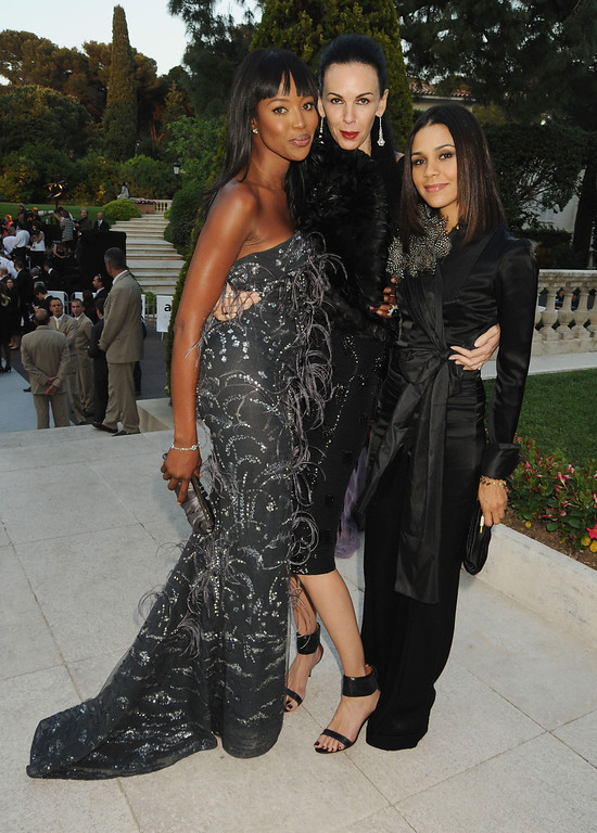 Description of . Naomi Campbell, L'Wren Scott, and Kadida Jones arrives at amfAR's Cinema Against AIDS 2010 benefit gala at the Hotel du Cap on May 20, 2010 in Antibes, France.  (Photo by Dave M. Benett/Getty Images for amfAR)