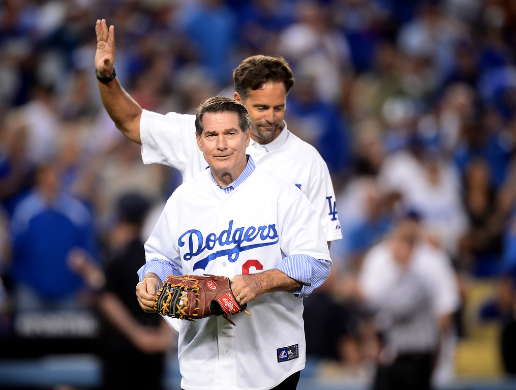 Description of . Former Los Angeles Dodger Steve Garvey throws out the first pitch before the Dodgers play the Atlanta Braves during game 4 of the NLDS at Dodger Stadium Monday, October 7, 2013. (Photo by Sarah Reingewirtz/Los Angeles Daily News)