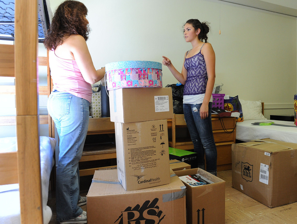 Description of . (John Valenzuela/Staff Photographer) Freshman student Danielle Davis and her mother Mollie Andersen of San Diego, unpacks inside her dorm room, Wednesday morning during move-in day at the University of Redlands, August 28, 2013.