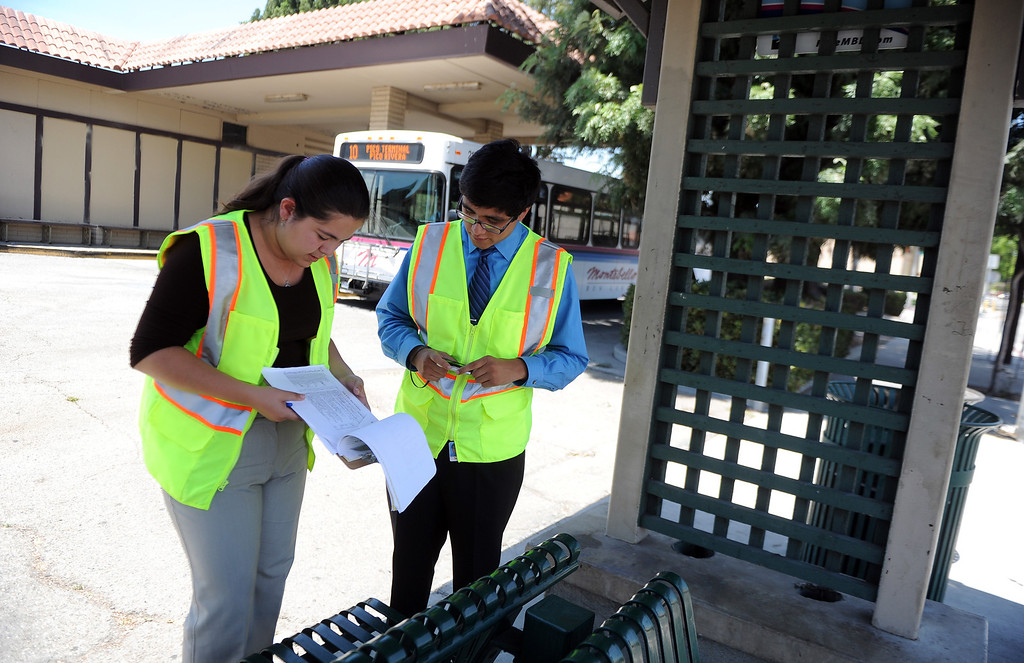 Description of . Interns Monserrat Marquez, left, a former El Rancho graduate along with Robert Sanchez a La Serna graduate go over a checklist as they inspect a bus stop at the corner of Passons Blvd and Jackson Street as part of the Pico Rivera college prep program on Tuesday, July 16, 2013 in Pico Rivera, Calif.   (Keith Birmingham/Pasadena Star-News)