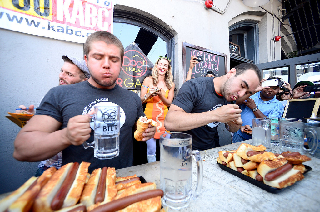 Description of . Dog Haus Biergarten in Old Pasadena holds their First Annual Hot Dog Eating Competition Saturday, July 6, 2013 in Old Pasadena. Jimmy Lin won after eating 11 dogs, 3 during a tiebreaker.  (SGVN/Staff Photo by Sarah Reingewirtz)
