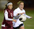 Downey's Lucy Martinez (12) gets to the ball ahead of Torrance's Brianna Brown (31) in a CIF SS Division IV quarterfinal game Thursday at Zamperini Field. Downey won the game 3-1. 20130221 Photo by Steve McCrank / Staff Photographer