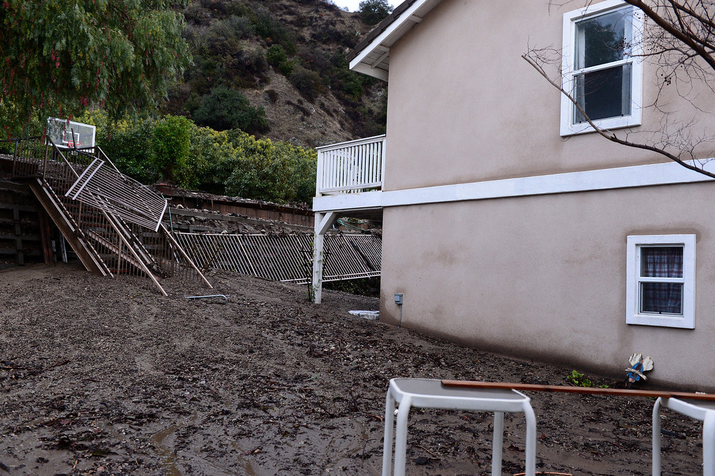 Description of . A home's backyard on Ridge View Drive in Azusa is buried in mud Saturday, March 1, 2014. The neighborhood sits below the Colby Fire burn area. (Photo by Sarah Reingewirtz/Pasadena Star-News)
