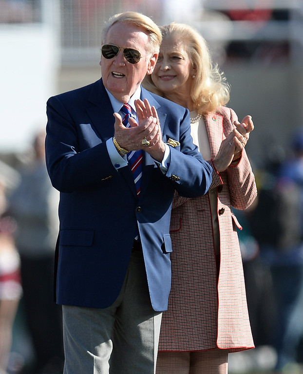 Description of . Dodgers announcer Vin Scully gets ready to flip the coin before Stanford plays Michigan State during the 100th Rose Bowl game in Pasadena Wednesday, January 1, 2014. (Photo by Hans Gutknecht/Los Angeles Daily News)