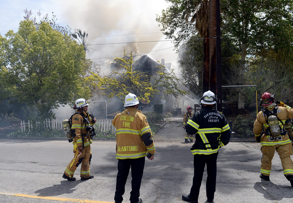 Description of . Firefighters from Redlands, San Bernardino County and San Bernardino Fire Departments, Loma Linda, as well as Cal Fire battled a two-alarm fire that destroyed a historic home in Redlands on Wednesday, April 9, 2014. (Photo by John Valenzuela/ Redlands Daily Facts)