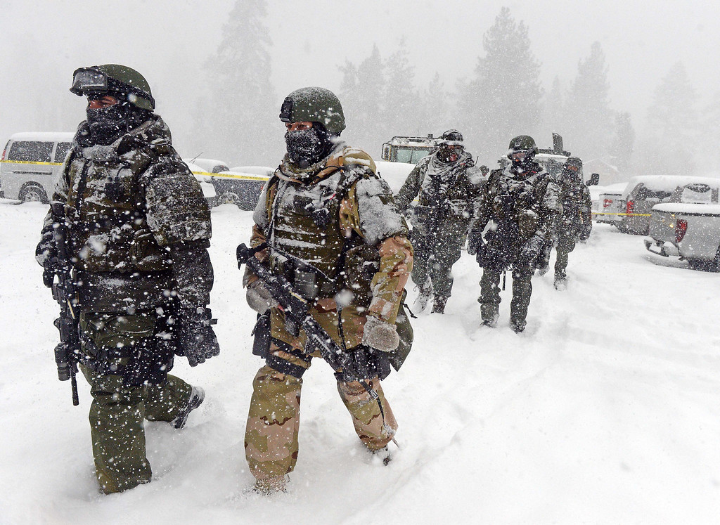 Description of . A San Bernardino County Sheriff SWAT team returns to the command post at Bear Mountain in Big Bear after searching for Christopher Jordan Dorner Friday February 8, 2013. Search conditions have been hampered as a heavy winter storm has hit the area. (Staff photo by Will Lester/Inland Valley Daily Bulletin)