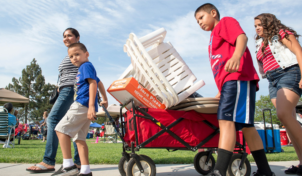 Description of . The Garcia family hauls supplies in a wagon for La Mirada's annual Independence Day Celebration at La Mirada Regional Park July 3, 2013.   (SGVN/Staff photo by Leo Jarzomb)