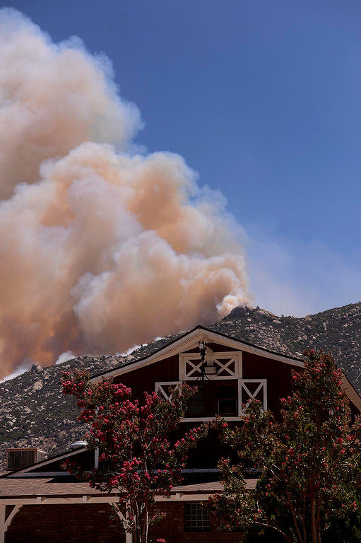 Description of . Smoke from the Silver Fire billows behind Twin Pines Ranch in the mountains south of Banning August 8, 2013.   GABRIEL LUIS ACOSTA/STAFF PHOTOGRAPHER.