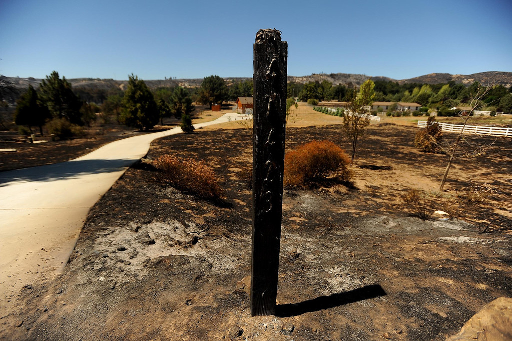 Description of . An address post stands damaged by the Silver Fire stands along Twin Pines Road in the mountains south of Banning August 8, 2013.   GABRIEL LUIS ACOSTA/STAFF PHOTOGRAPHER.