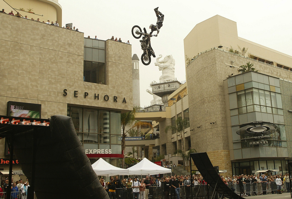 Description of . 6/17/04--HOLLYWOOD-- ESPN's X Games marked the launch of ticket sales for the event which starts August 5th by having three Moto X icons do some serious jumping in front of the Hollywood and Highland Center Thursday. HERE BRIAN DEEGAN GETS SOME SERIOUS EXTENSION ON HIS JUMP ABOVE HOLLYWOOD BLVD. The X Games include skateboarding, bike stunts, moto x, wakeboarding and inline skating competitions. DAVID SPRAGUE/DAILY NEWS