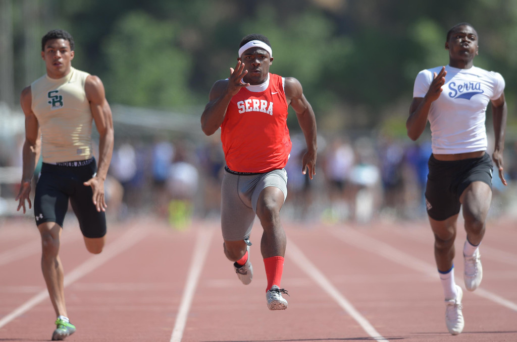 Description of . Serra's Malik Roberson, center, powers to a win in the 100 meter Division 4 race of the CIF Southern Section Track and Field Championships Saturday at Mt. SAC. Teammate Darrell Fuery, right, took second. 20130518 Photo by Steve McCrank / Staff Photographer