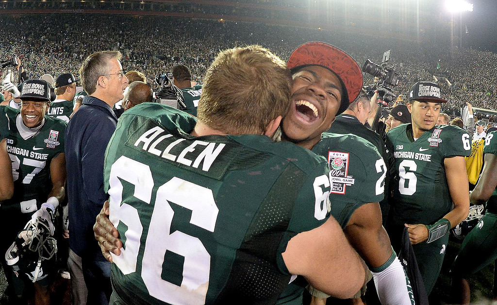 Description of . Michigan State's Mark Meyers (29) smiles with teammate Jack Allen (66) after defeating Stanford 24-20 during the 100th Rose bowl game in Pasadena, Calif., on Wednesday, Jan.1, 2014. 