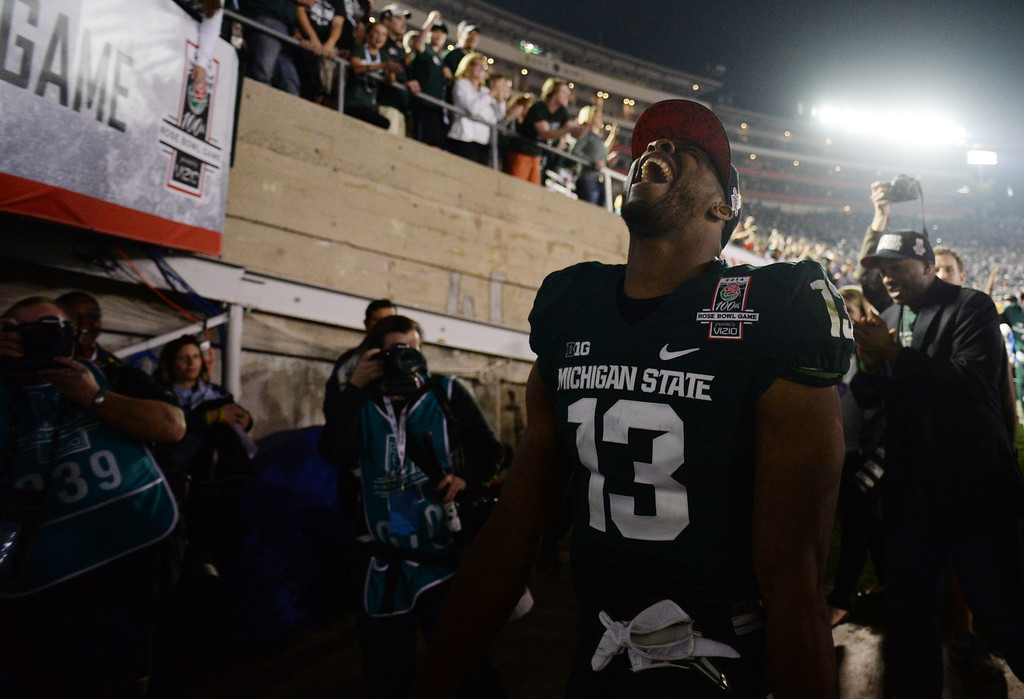 Description of . Michigan State's Bennie Fowler #13 reacts as he walks in to the locker room after winning the 100th Rose Bowl game in Pasadena Wednesday, January 1, 2014. Michigan State defeated Stanford 24-20. (Photo by Hans Gutknecht/Los Angeles Daily News)