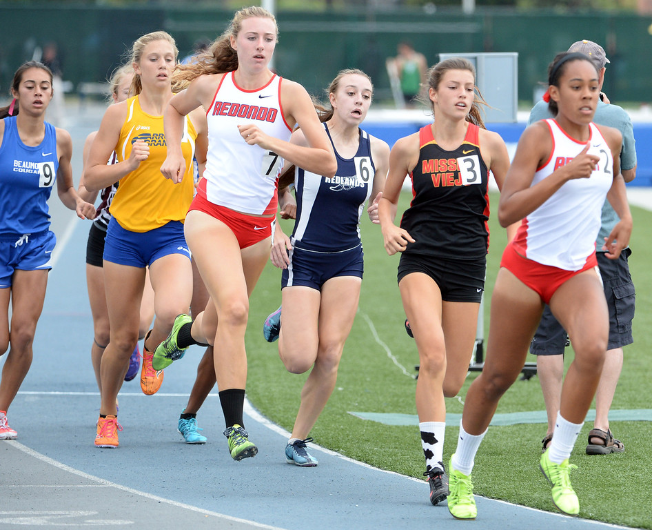 Description of . Redondo's Anevay Hiehle (7) along with Redlands's Claire Crowley, center, competes in the division 2 800 meters race during the CIF Southern Section track and final Championships at Cerritos College in Norwalk, Calif., Saturday, May 24, 2014. 