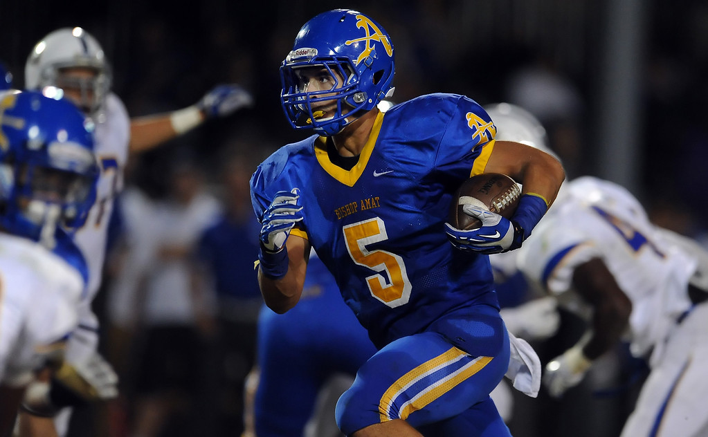 Description of . Bishop Amat's Anthony Camargo (C) (5) runs for a first down against Charter Oak in the first half of a prep football game at Bishop Amat High School in La Puente, Calif. on Friday, Sept. 20, 2013.    (Photo by Keith Birmingham/Pasadena Star-News)