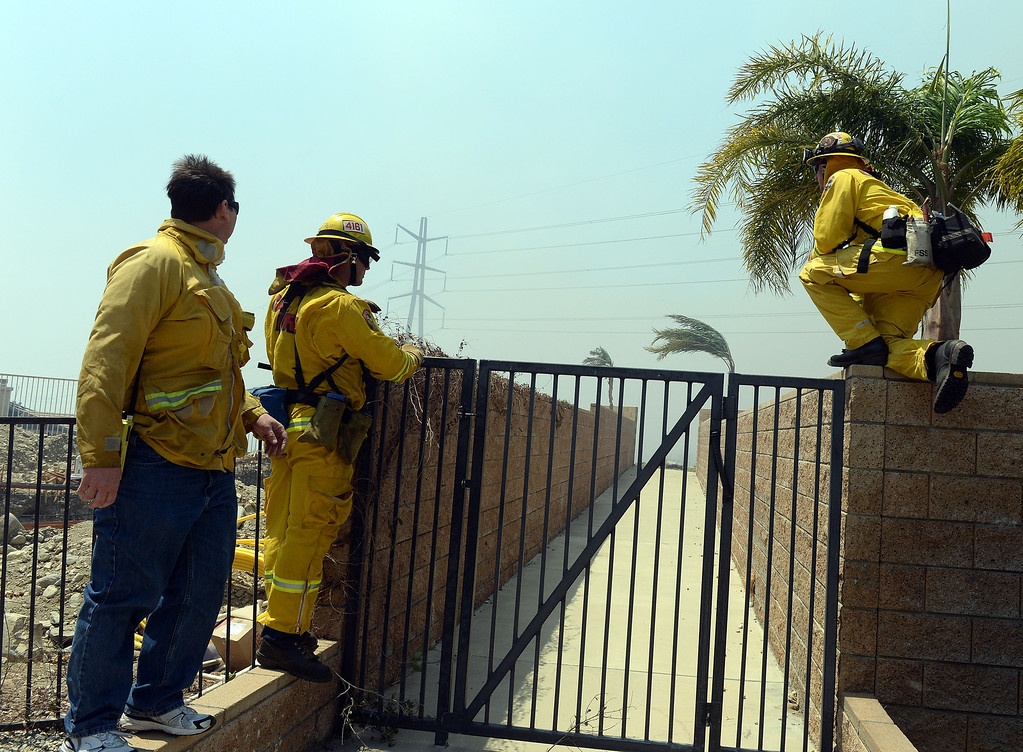 Description of . Firefighters watch as the Etiwanda Fire moves through Rancho Cucamonga Wednesday. Over 1,000 acres and over a 1,000 homes are under mandatory evacuation as the Etiwanda Fire burns in Rancho Cucamonga Wednesday April 30, 2014. Cause of the fire is unknown and is burning in areas which burned during the Grand Prix Fire in October 2003. (Will Lester/Inland Valley Daily Bulletin)