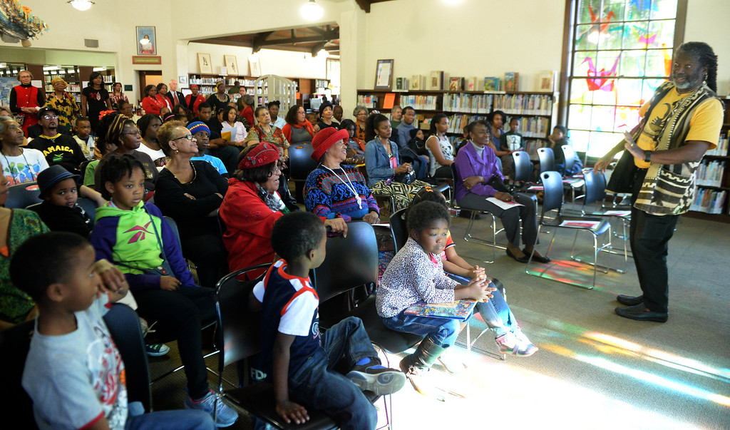 Description of . Michael McCarty tells a story about the boy who harnessed the wind during a Kwanzaa celebration at La Pintoresca Branch Library in Pasadena, Calif., on Friday, Dec. 28, 2013.     (Keith Birmingham Pasadena Star-News)