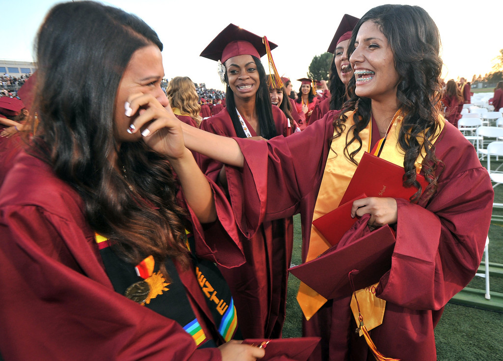 Description of . Stephanie Aguayo (right) wipes tears away from Emily Apodaca (left) after La Serna High School's 51st Annual Commencement at La Mirada High School stadium in La Mirada on Thursday June 13, 2013. La Serna marked the commencement of 635 graduates and marking Principal Ann Fitzgerald's first graduation as principal. (SGVN/Staff Photo by Keith Durflinger)