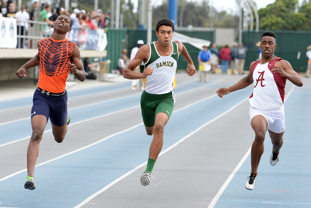 Description of . Damien's Thaddeus Smith, center, competes in the division 3 200 meters race during the CIF Southern Section track and final Championships at Cerritos College in Norwalk, Calif., Saturday, May 24, 2014. 