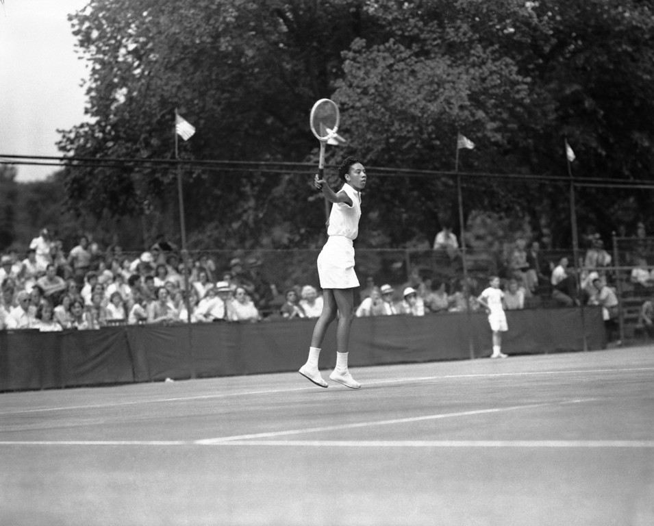 Description of . Althea Gibson, player from Florida A&M College, is shown in action at the U.S. Lawn Tennis Association Clay Courts championships in River Forest, Illinois, July 18, 1950. (AP Photo)