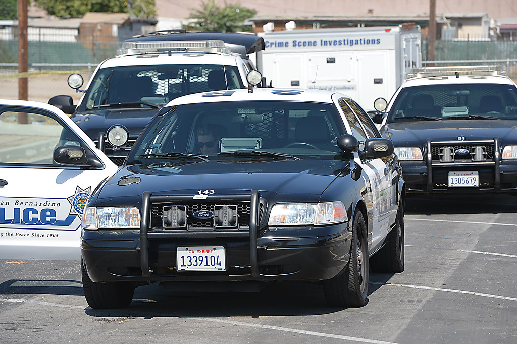 Description of . San Bernardino police are investigating an officer-involved shooting that wounded a man Tuesday June 24, 2014 at Nunez Park. Officers responded to a call about a suspicious person. When the man failed to comply with officers' commands, and they fired non-lethal ammunition - bean bags - at him, the man grabbed the shotgun from the officer and attempted to hit the officer with the weapon. Other officers shot the man with their service weapons. The man is in stable condition at Arrowhead Regional Medical Center. (Rick Sforza/The Sun)