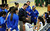 Bishop Amat head coach Richard Wiard talks to his team during a time-out in the second half of a CIF State Southern California Regional semifinal basketball game against Long Beach Poly at Bishop Amat High School on Tuesday, March 12, 2013 in La Puente, Calif. Long Beach Poly won 52-34. 