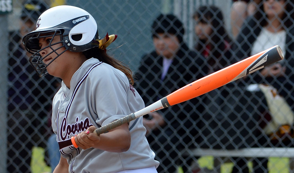 Description of . West Covina's Alex Rodriguez watches her RBI double in the first inning of a prep softball game against at Los Flores Park in La Verne, Calif., on Thursday, March 27, 2014. Bonita won 6-3. (Keith Birmingham Pasadena Star-News)