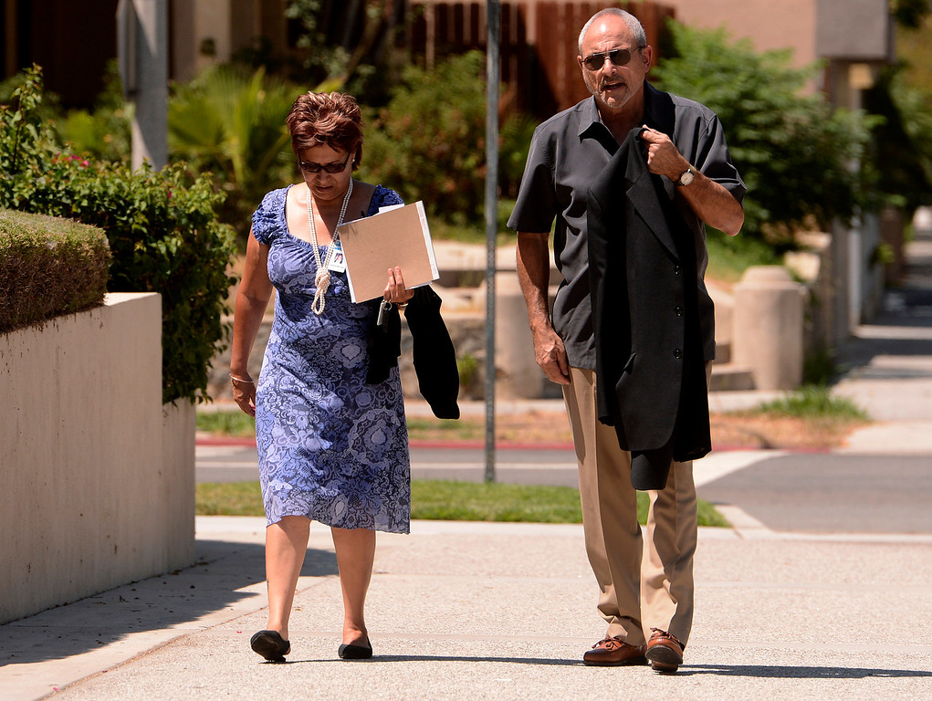 Description of . San Bernardino councilwoman Virginia Marquez and City Manager Allen Parker arrive to the United States Bankruptcy court in Riverside August 28,2013.  A tentative ruling by a Federal judge grants San Bernardino bankrupty protection.  GABRIEL LUIS ACOSTA/STAFF PHOTOGRAPHER.