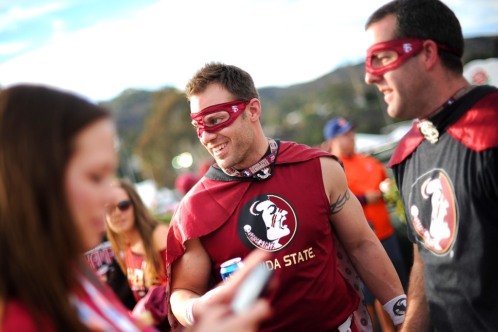 Description of . Florida State fans Josh Harness and Keith Marder enjoy pregame festivities in the parking lot prior to the 2014 Vizio BCS National Championship game at the Rose Bowl January 6, 2014.(Andy Holzman/Los Angeles Daily News)
