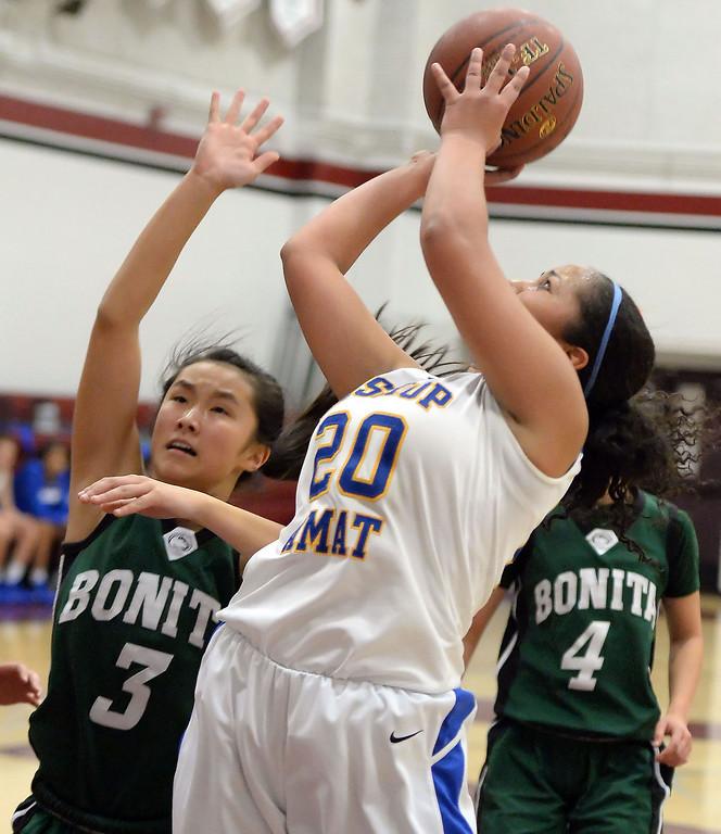 Description of . Bishop Amat's Janae Chamois (20) shoots past Bonita's Cassie Martinez (3) in the first half of the Covina basketball tournament at Covina High School in Covina, Calif., on Saturday, Dec. 14, 2013. Bonita won 49-41.   (Keith Birmingham Pasadena Star-News)